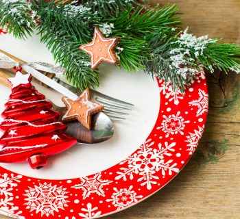 48369603 - christmas time table setting with vintage silverware on plate and napkin.