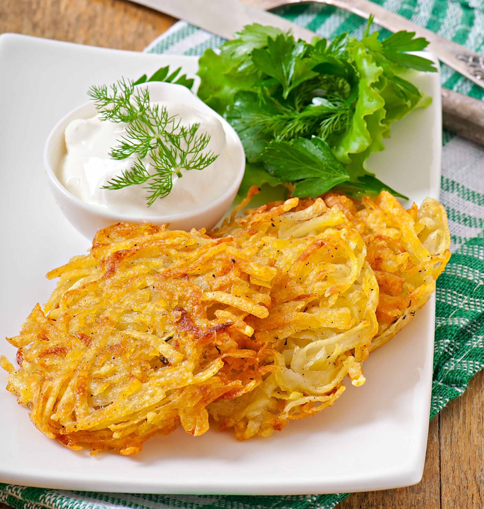 32949121 - fragrant potato pancakes with sour cream and herbs